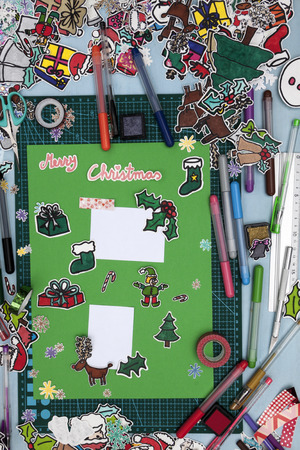 santa s elf: a vertical overhead view of a scrapbook xmas layout with a Happy xmas message in English