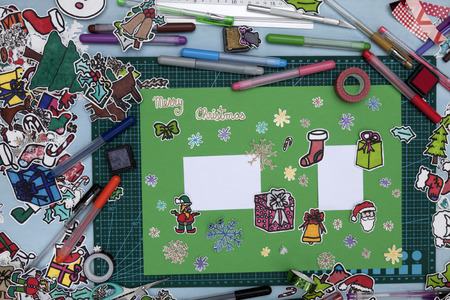santa s elf: a horizontal overhead view of a scrapbook xmas greeting with a Happy xmas message in English Stock Photo