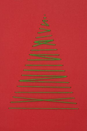 horizontal overhead view of a Christmas greeting tree made by a thread