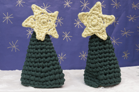snowed: a horizontal frontal view of some crochet trees in a snowed set