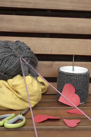 warmer: a vertical front view of the creation of a romantic mug warmer on a bench with some space for a message