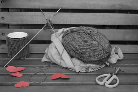 warmer: a horizontal frontal view of the creation of a romantic mug warmer on a bench with some space for a message in black and white with the hearts in red