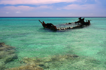 A rusted shipwreck sticks out of the shallow Caribbean waters Stock Photo - 1558547