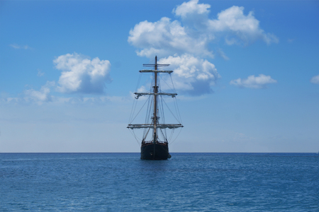 A pirate ship facing directly forward in the ocean