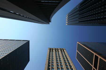 Looking up among towering skyscrapers Stock Photo