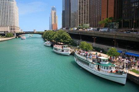 tour boats: Tour Boats lined up in the Chicago River on a summer day