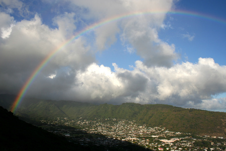 Almost complete rainbow arch over a valley on Oahu photo