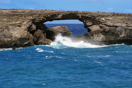 Rock formation over ocean waters in Hawaii