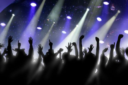arm raised: Fans raise their hands at a concert Stock Photo