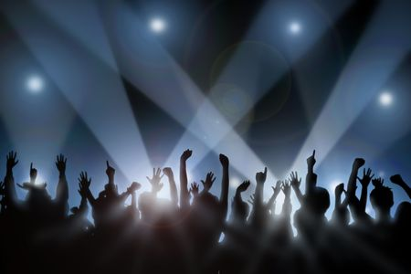 concert crowd: Fans raise their hands at a concert Stock Photo