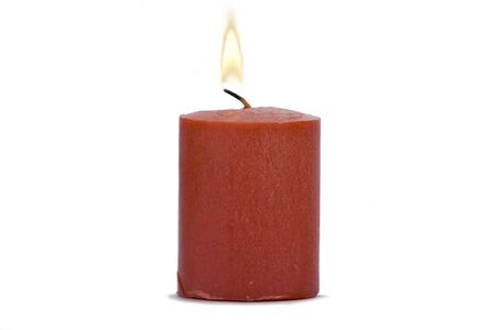 candle: Red candle burning on white