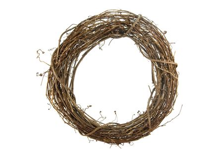 Wreath of sticks and vines isolated on white