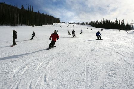 Crowd of skiers coming down slope