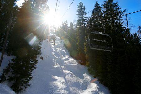 Looking up at moving ski lift