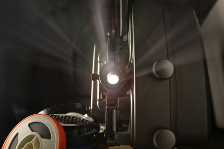Staring into the lens of an antique 8mm projector photo