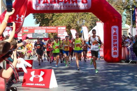 ODESSA, UKRAINE - CIRCA SEPTEMBER, 2019: Marathon runners on start of half-marathon in Odessa. Concept of competition, training, activity. 新闻类图片