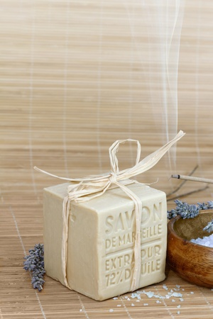 Bar of marseille soap, bath salt, lavender  photo