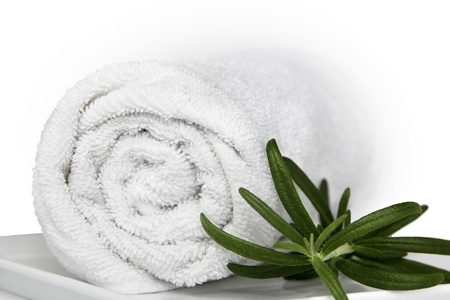 Closeup of the white bath towel with herbs  Isolated on white