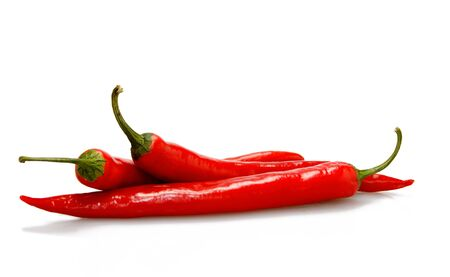 Three red hot chilli pepers isolated in white background