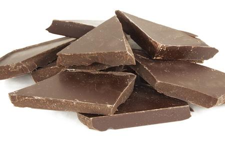 Chocolate blocks; close-up; isolated on white Stock Photo