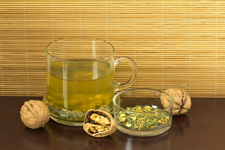 Close-up of green-tea (genmaicha) and walnut Stock Photo