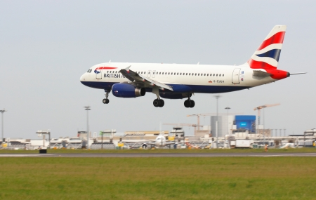 Lisbon Airport, 19 th May 2012  British airways aicraft landing with airport buildings in bakground