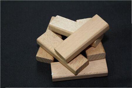 Wooden pieces in dark background Stock Photo