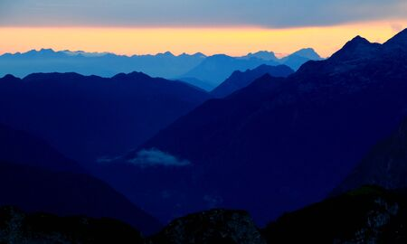 julian: Trenta and Soca (Isonzo) Valley during blue hour with Kanin group, Julian Alps, Slovenia and in the distance one hundred kilometers away peaks of  Carnic Prealps (from Monte Cavallo to Col Nudo), Italy