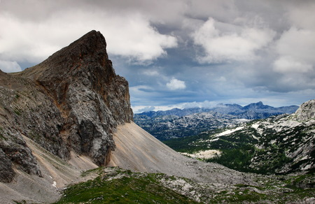 View of Seven Triglav Lakes Valley from the sharp Velika Zelnarica to the Krn peaks, under storm clouds, from Hribarice, Julian Alps, Triglav National Park, Slovenia, Europe