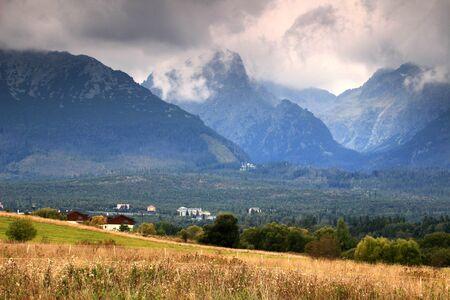 Slavkovsky peak, Prostredny hreben and Lomnicky ridge, between them the entrances to Velka and Mala Studena dolina valleys, with houses of Smokovec (High Tatras, Tatra National Park, Slovakia, Europe)