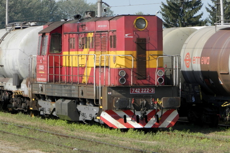 traction engine: TREBISOVSLOVAKIA - AUGUST 30, 2015: Diesel locomotive of Slovak railway hauls a tank car train at the station of Trebisov. The 742 class locomotive is common both in Slovakia and the Czech Republic. Editorial