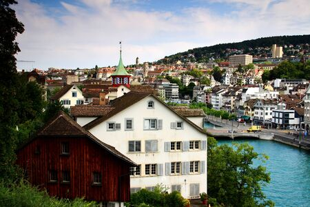 Colorful cityscape of Zurich Altstadt or old town with historic buildings on the river bank of Limmat, from Lindenhof hill, Switzerland, Europe