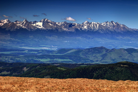 Poprad valley with eastern part of High Tatra range in the background, including its highest summits, Gerlach, Ladovy and Lomnicky peaks, in High Tatra National Park, from Low Tatras, Slovakia, Europe