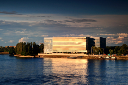 BUDAPESTHUNGARY - JUNE 10, 2017: Brand new Danube Arena, the venue for 2017 World Aquatics Championships, on the river bank of the blue Danube at sunset