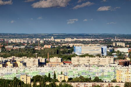 BUDAPESTHUNGARY - JUNE 10, 2017: Colorful apartment blocks in Obuda district, Budapest, with Danube Arena, the venue for 2017 World Aquatics Championships, in the background Editorial