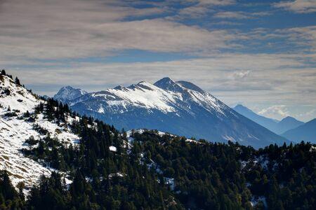 Snow-capped Stol  Hochstuhl, highest peak of Karavanke  Karawanken mountain range, with pine forests on steep slopes, on the border of Austria and Slovenia, Europe