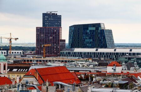 Vienna cityscape with skyline of historic and modern buildings, rooftops and walls in Innere Stadt old town and Landstrasse districts in city centre of Vienna Austria Central Europe