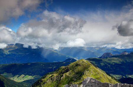 Summer rain shower sweeps over sunny Hochpustertal, Drava Drau valley, Kartitsch village, Villgratner and Gailtaler Alpen Lienzer Dolomiten mountains, view from Karnische Alpen Osttirol Austria Europe