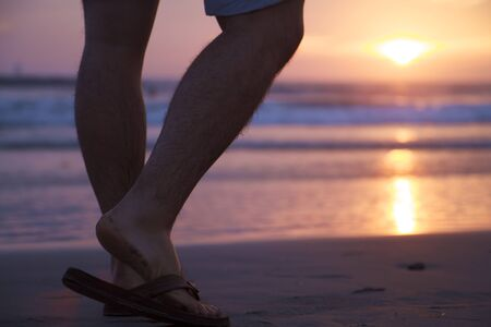 Feet Starting Walking on a Beach Sunset Stock Photo