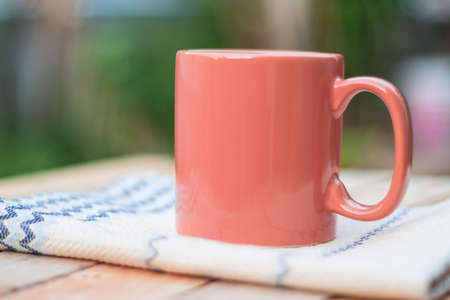 mocca: Coffee cup on wooden table Stock Photo