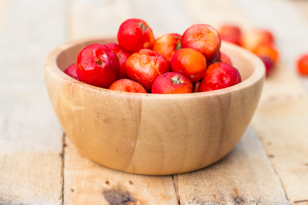 colour in: Cherry red color in wooden bowls. sofe focus