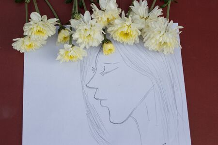 White flowers and a drawing of a girl who looks lonely.