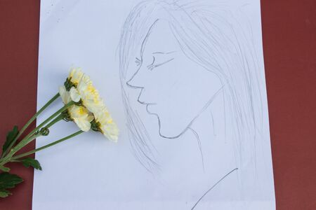 White flowers and a painting of a girl who looks lonely.