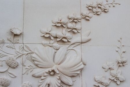 carved stone: Flowers carved stone walls