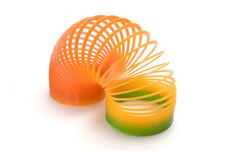 isolated plastic spring toy in white background photo