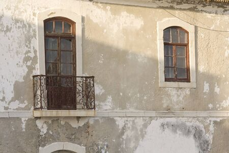 very old pair of close windows in a degraded wall Stock Photo - 7542411