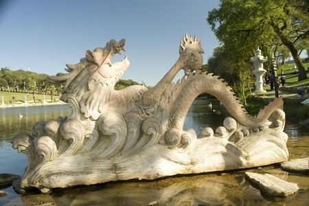 One big chinese dragon marble statue on the water photo