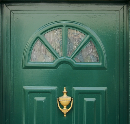 A fullframe of a green door made of wood Stock Photo