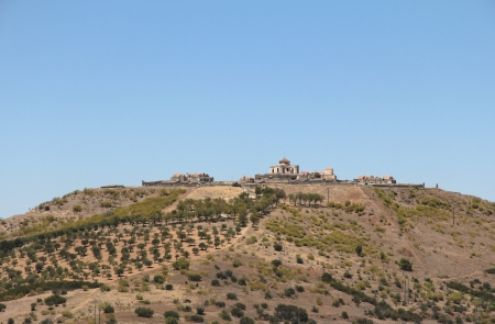 A Fortress in the top of one mountain with many trees