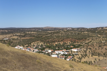 A vilage in the foregrownd with spain plains in the background  Stock Photo